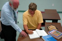 Accounting Professor Paul Muller helps a student.