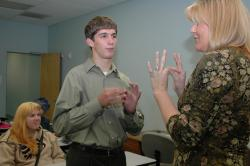 Sign Language Instructor Cindy Frank signs with one of her students.
