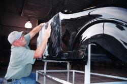A student works in the Auto Body lab