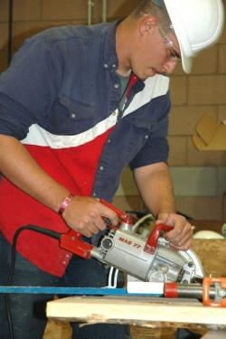 A construction student works on a project