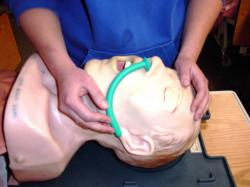 Students practice on a mannequin.