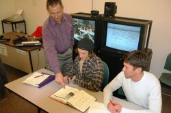 Professor Michael Hardie works with students in an interactive video classrom