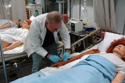 A nursing student works in the nursing lab