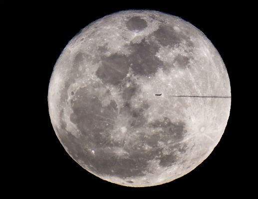 The moon and an airliner