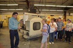 Professor Ed Martin speaks to students during a recent tour of WNCs Woody Wurster Machine Tool…
