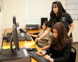 Andrade-Holt works with students during a GED Bootcamp class.