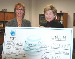Kris Wells of AT&T presents a check to President Lucey