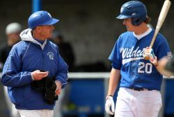 Western Nevada College coach D.J. Whittemore gives infielder Kody Reynolds some tips last season.