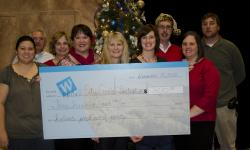 WNC staff presents check to CCCI Director Shelly Aldean