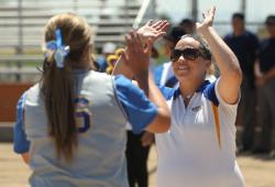 Coach Leah Wentworth Celebrates with a Player