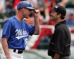 Head Coach DJ Whittemore greets an official prior to a game at the 2009 JUCO World Series in Grand…