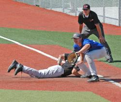 Eric Maupin tries for the out in the Region 18 semifinal game against College of Eastern Utah.