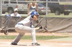 Matt Becker squeezes bunt.