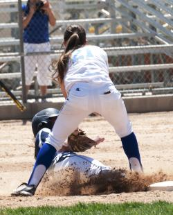 Jennifer Rechel makes play at second.