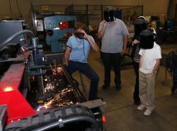 Visitors watch a welding demonstration during the 2014 Manufacturing Day at Western Nevada College.