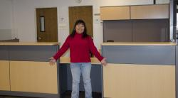 Linda Hipol-Rollings shows off new information desk