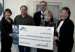 NV Energy representatives present a check to WNC.