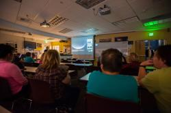 Visitors at the Jack C. Davis Observatory at Western Nevada College watch a live stream of the…