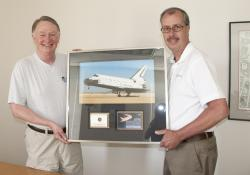 Robert Collier & Dan Neverett with Space Shuttle tile