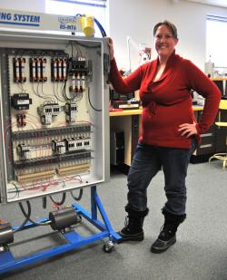 Lindsay Moore performs lab work that is essential in preparing students for the Manufacturing…