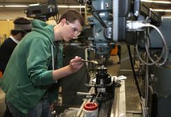 Students practice skills in the college machine shop.