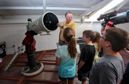 Robert Collier, director of the Jack C. Davis Observatory speaks to students in a College for Kids…