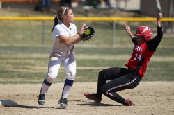 Melanie Pfeiffer sets up a double play.