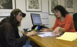 Disability Services Coordinator Susan Trist and a WNC student discuss techniques to manage his…