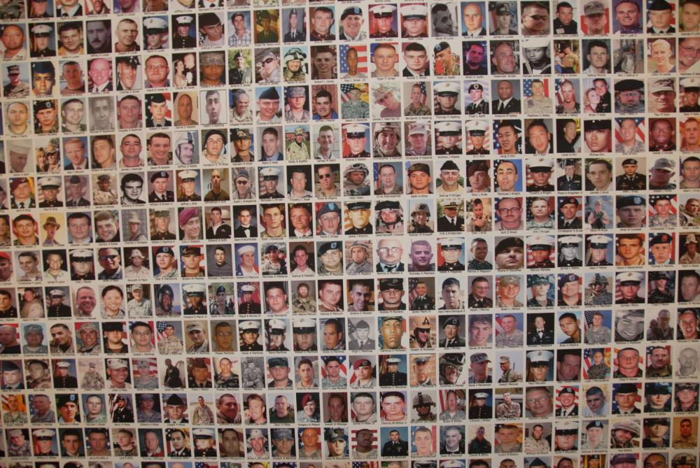 Photo panels depict more than 5,000 soldiers who have died.