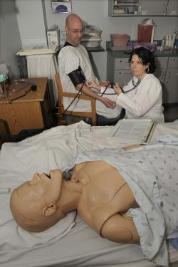 WNC nursing students use hands-on learning in the lab.