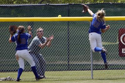 Jennifer Quam Reaches for Home Run Ball