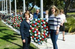 Marilee Swirczek, left, and Amy Roby participate in wreath-laying ceremony at a national veterans…