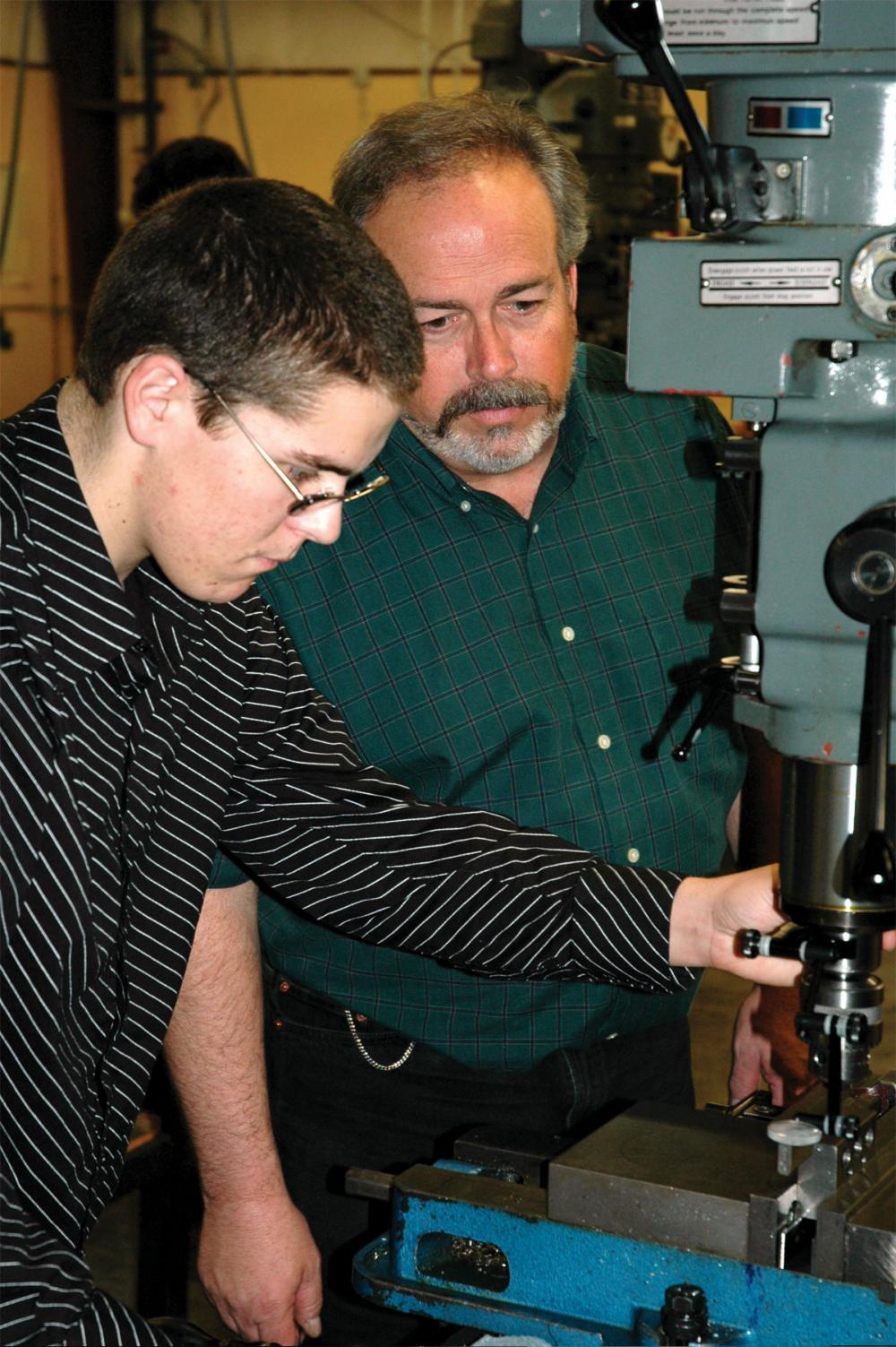 Paul Eastwood (right) works with a student