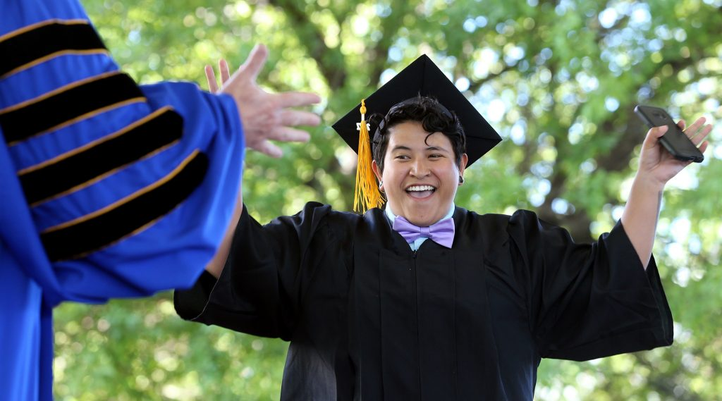 Isabel Meza, of Gardnerville, celebrates as she receives her diploma at the Western Nevada College 2017 Commencement in Carson City, Nev.