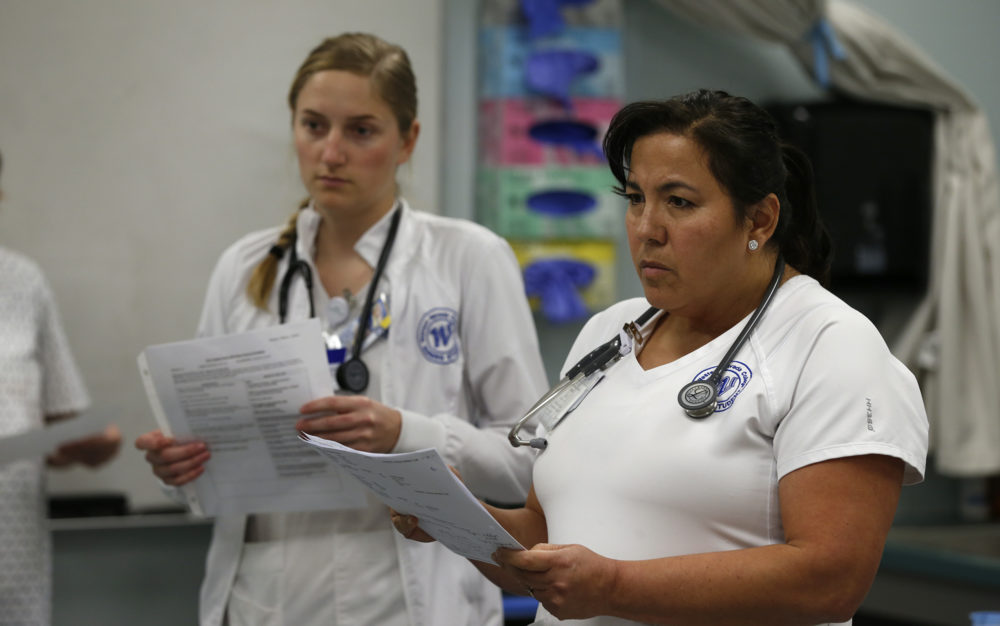Julia Guier and Angelica Munda work in a nursing lab at Western Nevada College, in Carson City, Nev., on Tuesday, April 9, 2019.   Photo by Cathleen Allison/Nevada Momentum